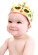 Cheeky baby wearing crown