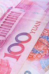 Cropped close-up of Chinese RMB banknotes with limited DOF