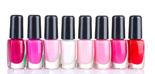 Group of nail polishes isolated on white