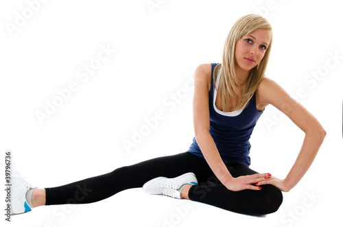 Fitness happy girl doing exercises on a floor