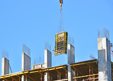 Crane with concrete formwork at construction site poster