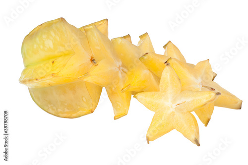 Riped carambola sliced into star shape isolated on white