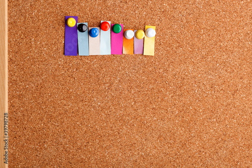 Cork board and colorful heading for eight letter word