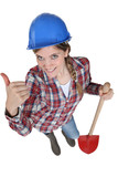 young female bricklayer holding shovel