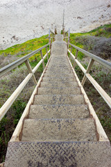 Steep staircase leading to sandy beach