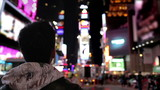 Times Square Tourist Snaps off Shot with Smart Phone