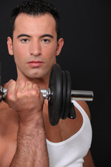 Strong man lifting barbell