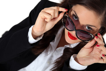 Businesswoman posing in sunglasses