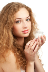 Woman with jar of  moisturizing cream