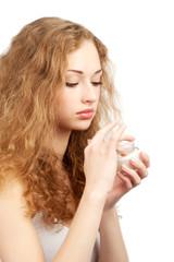 Woman with jar of  moisturizing cream