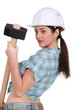 sexy woman holding a huge hammer