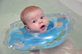 child swims with a rubber ring