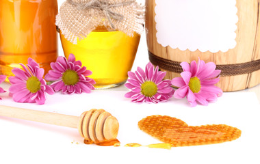 Honeycomb and honey isolated on white