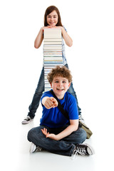 Students sitting close to pile of books on white