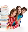 Students peeking behind pile of books on white