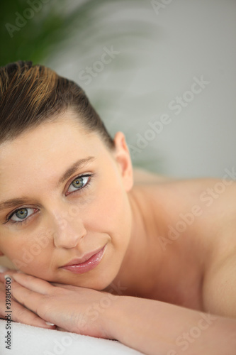Woman waiting for a message at the spa
