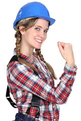 Female construction worker showing her strength