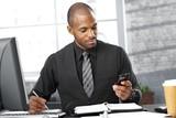 Smart businessman busy working