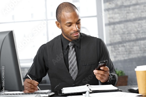 Smart businessman busy working