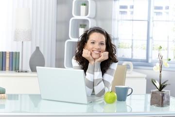 Happy woman in study