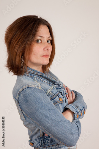 woman in blue jean jacket with arms crossed