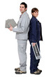 Man and woman holding tiles and cutter