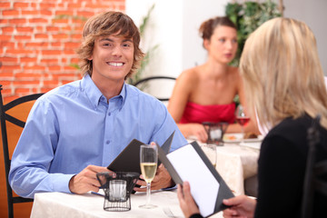Couple having meal in restaurant