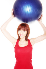 Smiling Woman Holding Pilates Ball