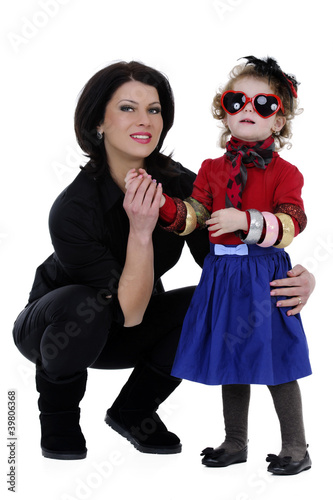young mother with her funny daughter studio shoot