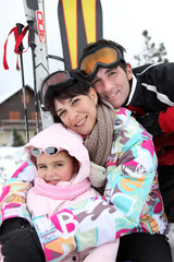 Young family on skiing holiday