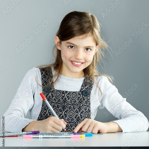 Sweet little child is painting a colourful picture