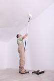 Mansard roof man painting