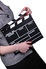Woman holding clapboard on white background