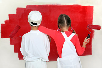 Children painting a wall