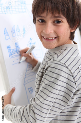 Child drawing on a whiteboard
