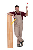 Worker with wooden flooring