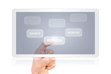 Hand pushing success word on tablet.