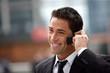 handsome businessman having phone call