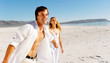 carefree walking beach couple