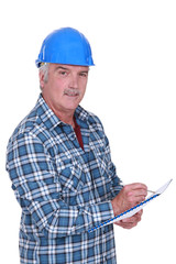 Construction foreman evaluating an employee