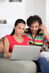 Couple enjoying modern technology
