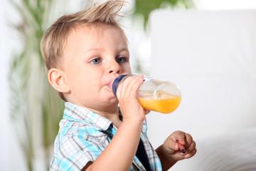 baby boy having his bottle