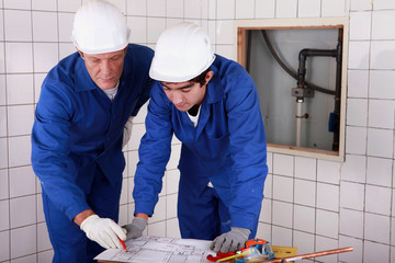 plumbers at work