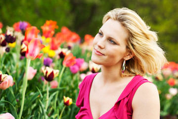Woman at park with tulips in spring