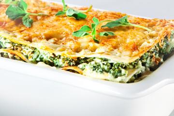Italian cuisine. Spinach lasagna with basil. Macro