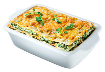 Spinach lasagna with basil and oregano Isolated. Clipping path