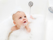 Infant in soap foam