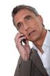 Mature man talking on a cellphone