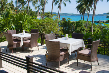 Table and chairs with a beautiful sea view . Thailand .