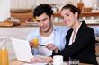 A modern couple having breakfast.